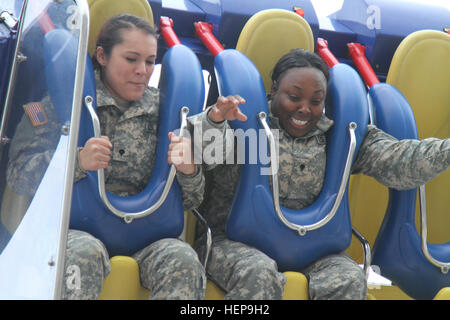 Soldiers from Fort Hood, Texas, enjoy a carnival ride at the Houston Livestock show and Rodeo, March 5. The soldiers - Stock Photo