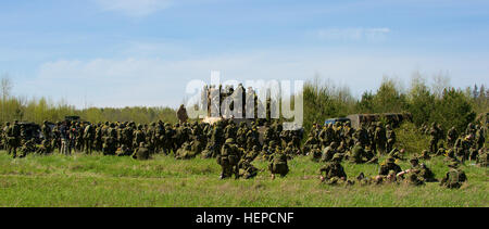 Soldiers from the Estonian Defense Forces' Kuperjanov Infantry Battalion observe an M1A2 Abrams Battle Tank from - Stock Photo