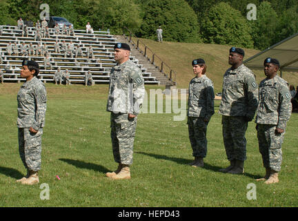 As the brigade S1 and adjutant of the ceremony, Maj. Sabrina Thweatt (front) awaits their arrival, the commander - Stock Photo