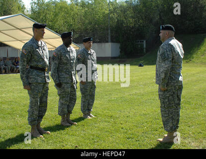 The commander of troops, Lt. Col. Richard Fornili, salutes as the reviewing party, (from left to right) Maj. Gen. - Stock Photo