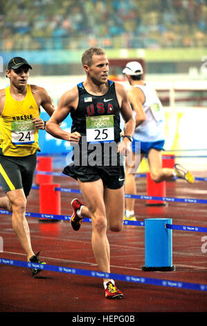 U.S. Air Force Capt. Eli Bremer runs to a seventh-place finish with a time of 9 minutes, 19.61 seconds that's worth - Stock Photo