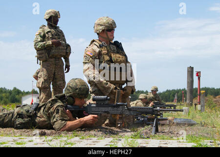 Sgt. David Pileggi, a squad leader with P Troop, 4th Squadron, 2nd Stryker Cavalry Regiment, operates as an assistant - Stock Photo