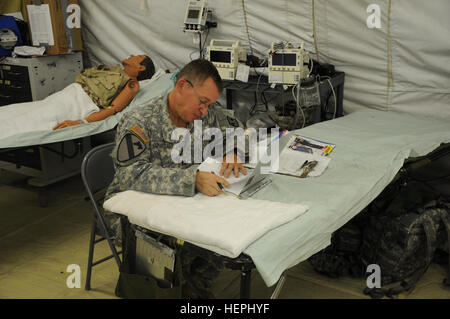 Capt. Dennis Consolver, an intensive care unit registered nurse in the U.S. Army Reserve with Bravo Company, 325th - Stock Photo