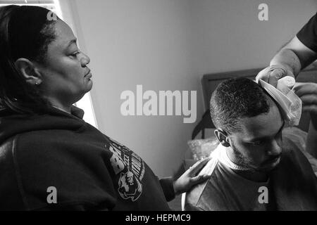 Delores Livingston consoles her son, Pfc. Jose Sierra, after his surgery at Fort Bliss, Texas, Nov. 24, 2015. (U.S. - Stock Photo