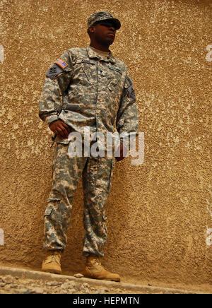 CAMP TAJI, Iraq--Spc. Damone Abdus Salaam, paralegal specialist, Headquarters and Headquarters Company, Combat Aviation - Stock Photo