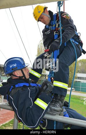 Firefighters Andrea Biasio and Federico Concordia assigned to the U.S. Army Garrison Italy, practice rappelling - Stock Photo