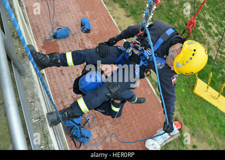 Firefighters Andrea Biasio and Federico Concordia assigned to U.S. Army Garrison Italy, practice rappelling at the - Stock Photo