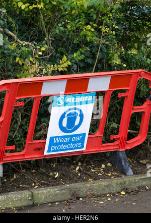 Road works barrier with safety sign Wear ear protectors 2016 - Stock Photo