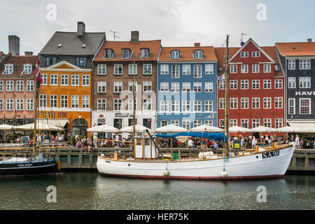 Coloured buildings and tall wooden ships in Nyhavn, Copenhagen - Stock Photo