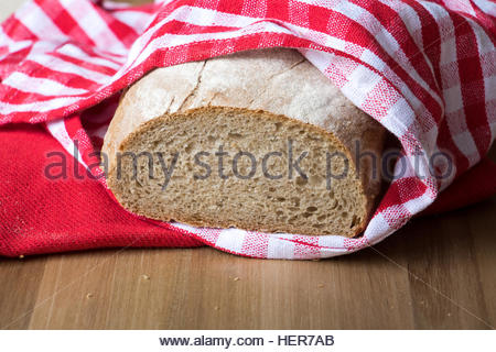 Organic Bread brown loaf food background wholegrain loaf bread close up crusty bread organic food fresh bread round - Stock Photo