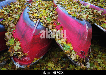 turned red rowboats in the Tiergarten, Berlin - Stock Photo