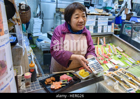 Sashimi fish seller in Nishiki Market, Kyoto, Japan - Stock Photo