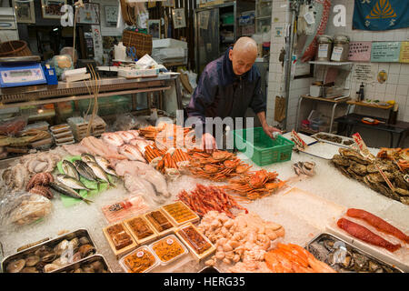 Seafood seller in Nishiki Market, Kyoto, Japan - Stock Photo