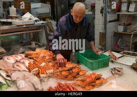 Seafood seller in Nishiki Market, Kyoto, Japan - Stock Photo