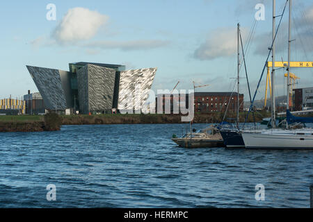 View across Belfast Harbor showing the iconic Titanic building built as part of the redevelopment of the harbor - Stock Photo