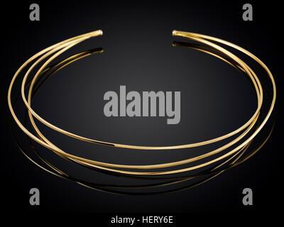 Golden necklace isolated on black background. - Stock Photo