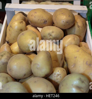 Potatoes inside Wooden Box for Sale in Market - Stock Photo