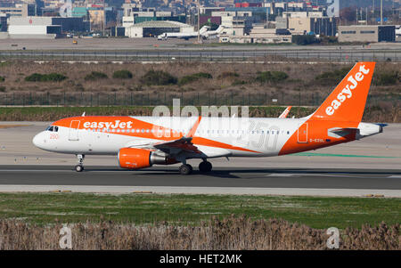 Easyjet Airbus A320 250th Airbus Livery taxiing along the runway at El Prat Airport in Barcelona, Spain. - Stock Photo