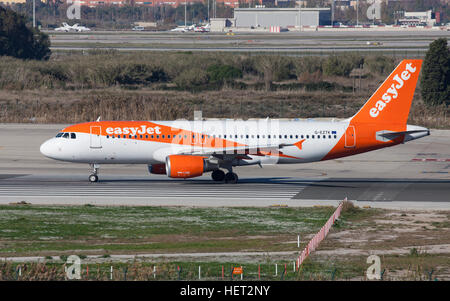 Easyjet Airbus A320 taxiing along the runway at El Prat Airport in Barcelona, Spain. - Stock Photo