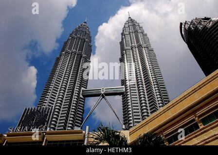 Kuala Lumpur, Malaysia - December 23, 2007:  The 1,482 foot high 1987 twin Petronas Towers with connecting sky bridge designed by Cesar Pelli  *