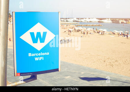 signboard of free wifi in Barcelona, spain, near to the beach on a sunny day. - Stock Photo