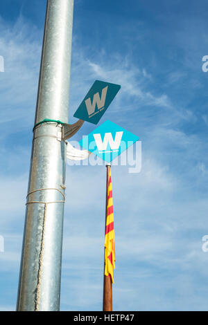 Sign of free wifi hotspot in Barcelona on a sunny day and a flag of Catalonia at the background. - Stock Photo