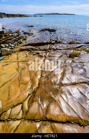 Colourful rocky shore at Knockbrex, near Carrick, Solway Firth, Dumfries & Galloway, Scotland - Stock Photo