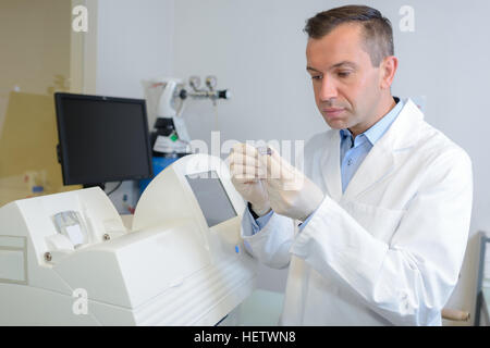 happy young male researcher working in his lab - Stock Photo