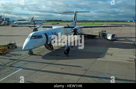 Flybe air plane G-JECJ Bombardier Dash-8 Q400 arriving Manchester Ringway Airport, England, UK - Stock Photo