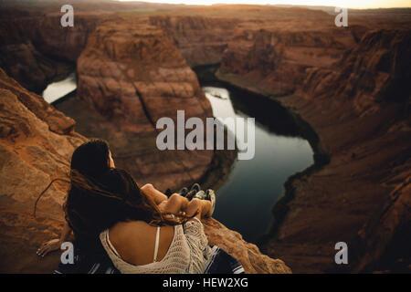 Women relaxing and enjoying view, Horseshoe Bend, Page, Arizona, USA - Stock Photo
