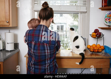 Rear view of mother holding sleeping baby boy - Stock Photo