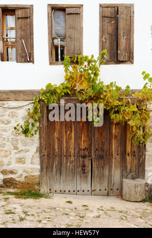 Windows and wooden doors of an old houses in a Yoruk village near Kastamonu province - Stock Photo