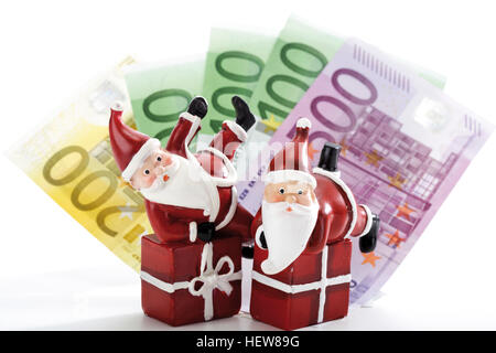 Santa Claus figures on gifts with Euro bills - symbol for Christmas bonus - Stock Photo