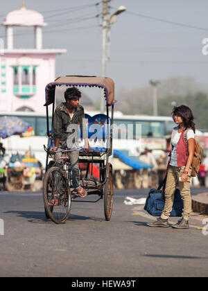 rickshaw driver and a modern indian young woman are in the streets of Agra.Rickshaw ( tuk tuk ) - Stock Photo