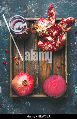 Ripe seasonal pomegranates, beetroot and freshly squeezed juice in glass - Stock Photo