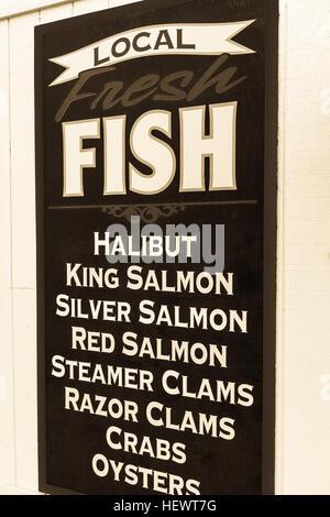 Fishmongers shop sign, Homer Spit, Kachemak Bay, Alaska, USA - Stock Photo