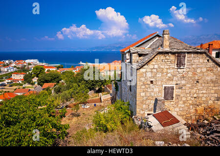 Old stone village Postira on Brac island, coast of Dalmatia, Croatia - Stock Photo