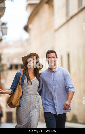 Couple walking on street, Palma de Mallorca, Spain - Stock Photo