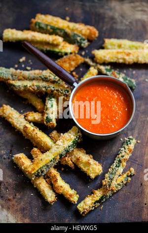 Zucchini fires with roast pepper and tomato sauce