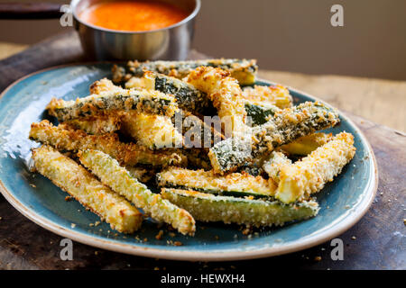 Zucchini fires with roast pepper and tomato sauce - Stock Photo