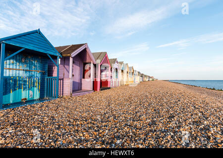 Row of English traditional beach huts at Herne Bay on the Kent coast. Painted in various mainly pastel shades. Early - Stock Photo