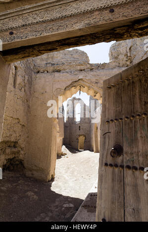 The carved timber lintel and doorway of a home in an ancient desert village. - Stock Photo