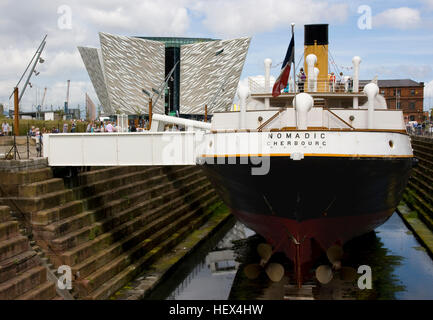 S S Nomadic, tender to the Titanic lying in Hamilton Dock, Belfast home of Titanic with the Titanic building in - Stock Photo