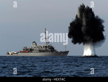 101119-N-6266K-023 STRAITS OF HORMUZ (Nov. 19, 2010) A demolition charge detonates 1,500 meters from Avenger-class - Stock Photo