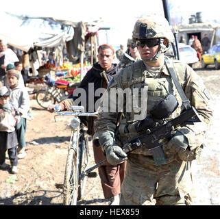 U.S. Army Spc. Leonardo Cabados of Los Angeles, 4th Platoon, Charlie Company, 2nd Battalion, 30th Infantry Regiment, - Stock Photo