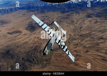 An A-10 Thunderbolt II from the 23rd Fighter Group, Moody Air Force Base, Ga., peels away after being refueled from - Stock Photo