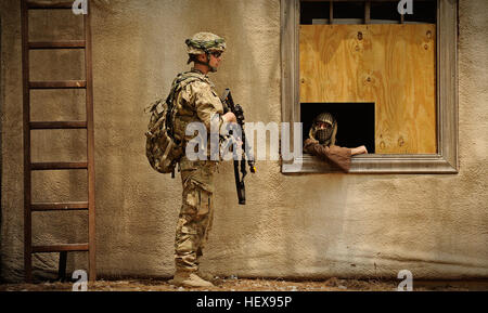 Pfc. Dustin Corbin, infantryman attached to Laghman Provincial Reconstruction Team,pulls inner cordon security while - Stock Photo