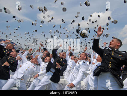 Newly commissioned Navy and Marine Corps officers toss their hats during the U.S. Naval Academy Class of 2011 graduation - Stock Photo