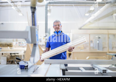 Portrait of carpenter in architectural stone factory - Stock Photo