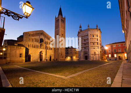 Early morning twilight over the Duomo and Baptistery in Piazza del Duomo, Parma, Emilia-Romagna, Italy - Stock Photo